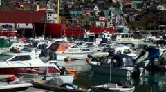 Greenland small town Qaqortoq 073 small boat leaves harbor Stock Footage