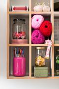 Knitting Materials Arranged Neatly in Rectangular Shelf - stock photo