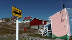Greenland small town Qaqortoq 069 bus stop below a settlement on hill Stock Footage