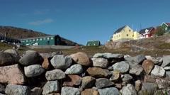Greenland small town Qaqortoq 067 primitive stone wall in the village Stock Footage