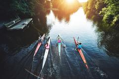 Team of rowing people Stock Photos