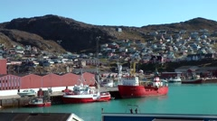 Greenland small town Qaqortoq 066 ships in small harbor and turquoise water Stock Footage