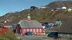 Greenland small town Qaqortoq 064 wooden chapel seen from a hill from far Stock Footage