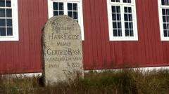 Greenland small town Qaqortoq 062 memorial stone at church nave Stock Footage