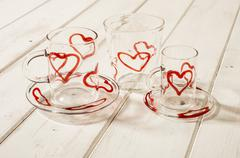 Stock Photo of Crystal Drinking Set Red Hearts Design on Wooden Panel