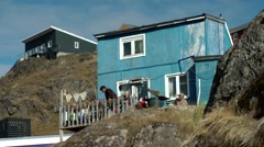 Greenland small town Qaqortoq 058 house between rocks, citizens on balcony Stock Footage