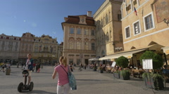 Walking in the Old Town Square, on a sunny day in Prague Stock Footage