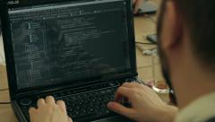 programming in action. Man typing on a laptop keyboard,corporate,social network - stock footage