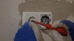 Electrician at work, assembly  sockets  - stock footage