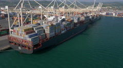 Aerial - Cargo ship at commercial dock - stock footage