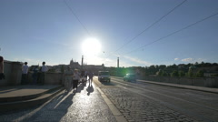 Walking and riding stand up scooters on Manes Bridge, Prague Stock Footage