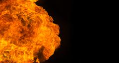 Fire flame explosion on black background - stock photo