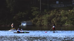 People on a Jet Ski, Kayak Stand Up Paddle Board at Whoahink Lake Stock Footage