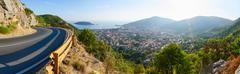 Panoramic views of mountain road and city of Budva on coast, Montenegro Stock Photos