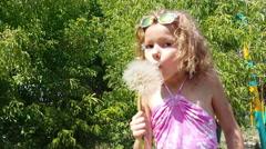 Girl blowing dandelion Stock Footage