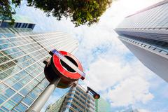 Underground sign in Canary Wharf financial district in London, UK. Stock Photos