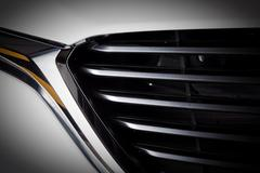 Stock Photo of Modern luxury car close-up of grille. Expensive, sports auto detailing