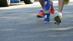 Legs of people running 100 fps Stock Footage