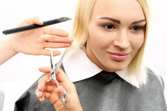 The woman at the hairdresser Stock Photos