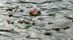 Water Pollution floating rubbish and garbage Stock Footage