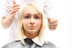 The woman at the hairdresser - stock photo