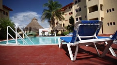 Mexico, Cancun - 23.10.2015: Lounge sunbed near swimming pool Stock Footage