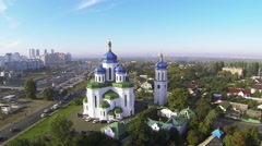 Stock Video Footage of   Orthodox Christian church with blue domes in Kiev, capital of Ukraine. Aerial