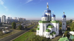 Up over Orthodox Christian church with blue domes in Kiev, capital of Ukraine.  - stock footage