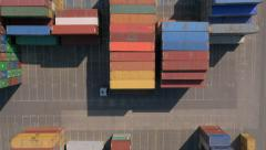 Aerial, vertical - Shipping containers and cargo trucks at port Stock Footage