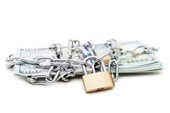 Chain link with padlock on dollar currency money - stock photo