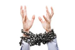 Businessman with metal chain tied hands raised for rescue help Stock Photos