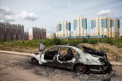 Arson fire burnt wheel car vehicle junk Stock Photos
