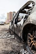 Arson fire burnt wheel car vehicle junk - stock photo