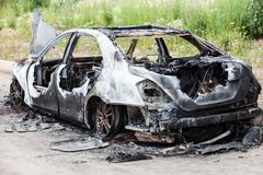 Arson fire burnt wheel car vehicle junk Stock Photos