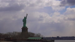 Time lapse of clouds behind the Statue Of Liberty in new York harbor. Stock Footage