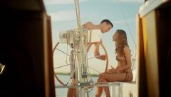 Love story. Guy and the girl relaxing at the weekend on a yacht. Stock Footage