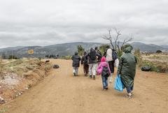 Refugees on the road to European Union - stock photo