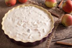 Traditional homemade apple pie with cinnamon preparation recipe on vintage - stock photo