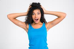 Amazed afro american woman looking at camera - stock photo