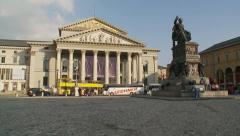 Bavarian National Theater square, zoom out from skateboarders Stock Footage