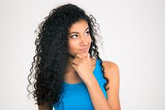 Pensive afro american woman looking up Stock Photos
