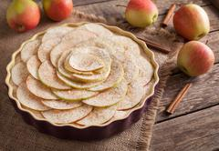 Homemade delicious traditional apple pie sweet dessert preparation recipe with Stock Photos
