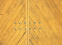 Yellow gate closeup with diagonal wooden strips Stock Photos