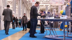 interest of the visitors to the submitted samples at the international exhibitio - stock footage