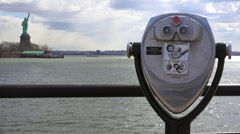 A coin operated viewer looks out at the Statue Of Liberty in New York harbor. Stock Footage