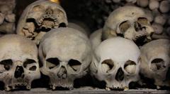 Human Skulls and bones handheld shot Stock Footage