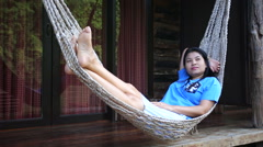 Asian woman relax on a hammock - stock footage
