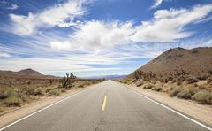 Endless country highway, Death Valley, California, USA. - stock photo