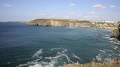 Coast at Mawgan Porth north Cornwall uk PAN Stock Footage