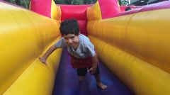 Child exercise on inflatable bouncy castle Stock Footage